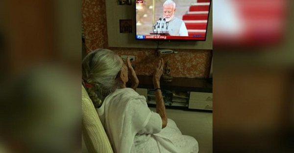 As PM Modi takes oath in Delhi, his mother cheers watching son on TV in Ahmedabad